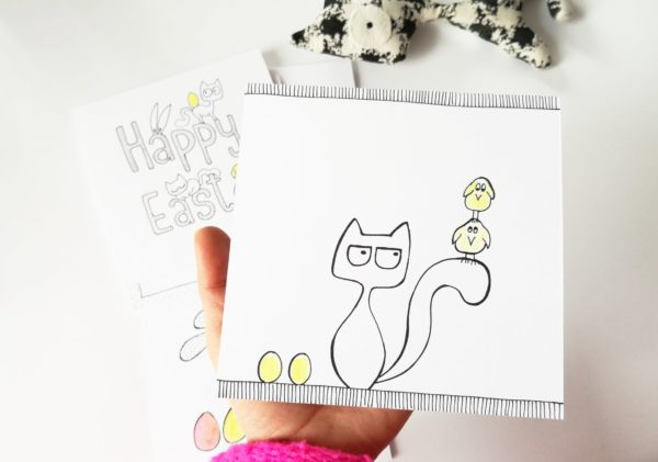 Easter greetings card, cat with chickens on tail, yellow easter eggs, handmade drawing