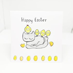 Easter greetings card with cat in polka dots pattern and yellow chickens on his back, handmade art