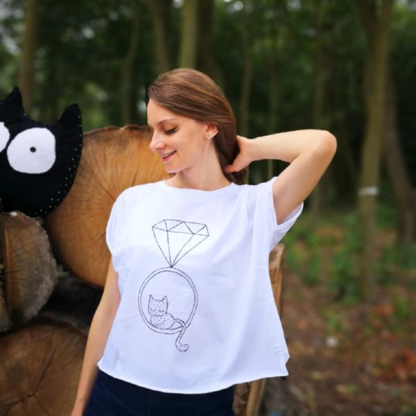 smiling girl in hand painted tee with graphic inside ring with diamond