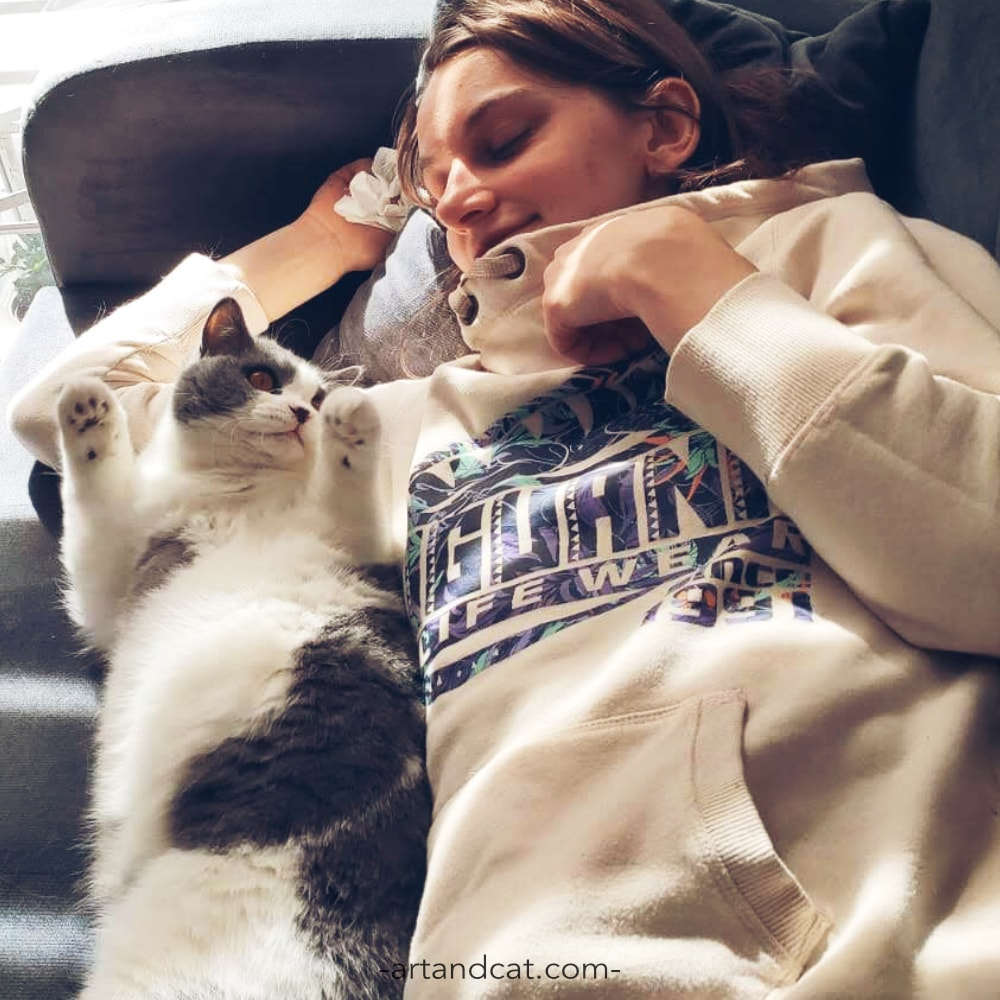 smiling girl with british cat blue and white slow life in cat's way hygge